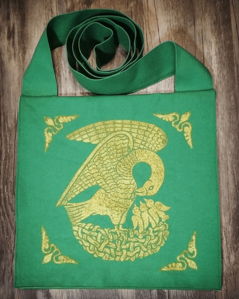 15th century Pelican bag made from green cotton canvas, lined with yellow cotton fabric & printed with a hand carved 15th century Pelican stamp in gold.