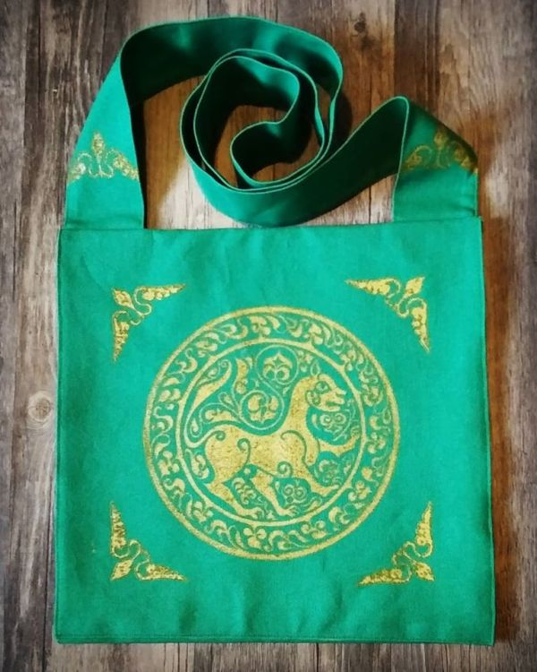 11th century lioness bag made from green cotton canvas, lined with yellow cotton fabric, hand printed with a hand carved 11th century middle eastern inspired lioness stamp.