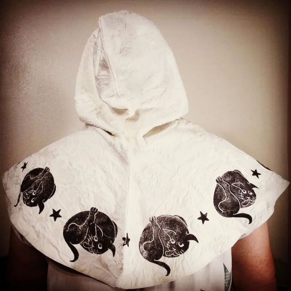 Hood with 16th century butt-licking cat print, lined with soft black organic cotton fabric & hand printed with a hand carved 16th century butt-licking cat stamp.