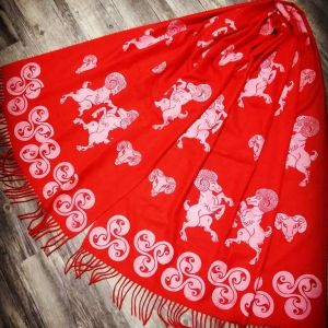 Red soft scarf with ram & triskele print. Hand printed with hand carved stamps. The ram & triskele scarf is new, pre-washed, ready to wear & machine washable!