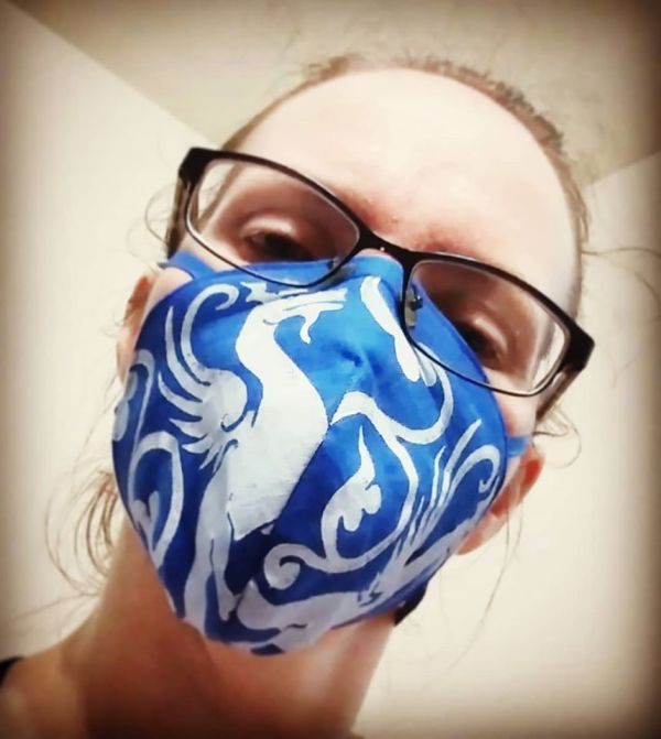 Blue linen face mask with extra long ties and white 13th century dragon print. New, pre-washed fabric, ready to wear and machine washable!
