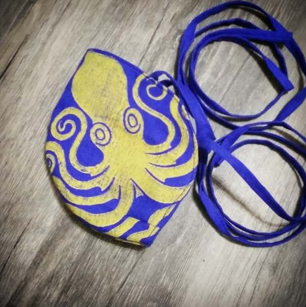 Blue linen octopus face mask with extra long ties and yellow octopus print. New, pre-washed fabric, ready to wear and machine washable!