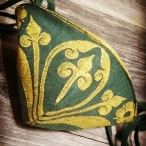 Dark green linen face mask with long ties and premium gold 13th century fleur-de-lis print. New, pre-washed fabric, ready to wear and machine washable!