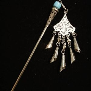 Beautiful metal hair stick in silver color with light blue glass bead. Has a good weight and a lovely shine - pretty jewelry for your hair!