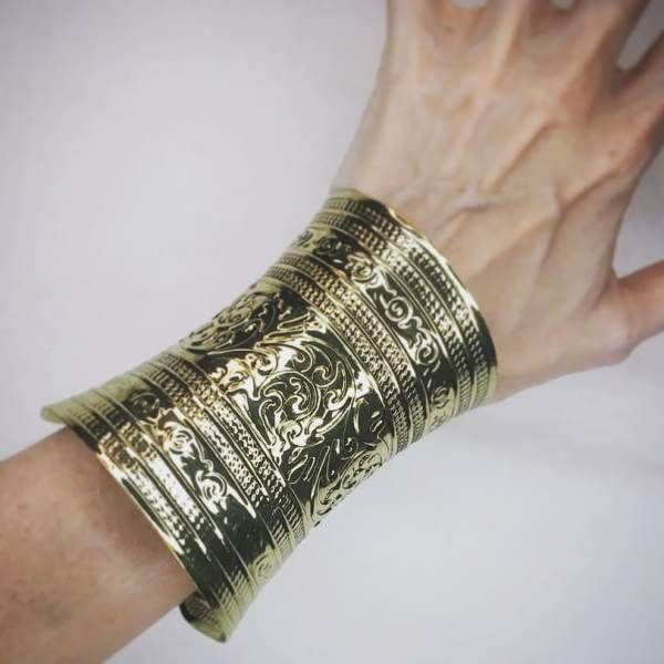 Pretty lightweight metal bracelets/cuffs in antique brass color as lovely addition for your everyday clothing or event garb.