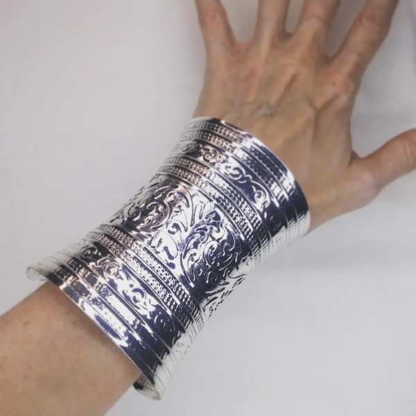Pretty lightweight metal bracelets/cuffs in antique silver color. A lovely addition for your everyday clothing or event garb.