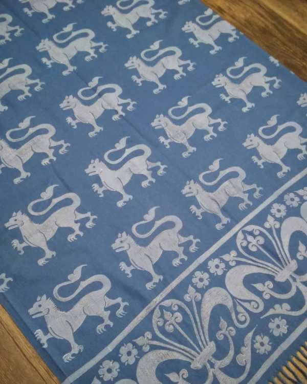 Wearable art in form of a soft & cozy blue scarf with 13th century lion & fleur-de-lis print. Hand printed in white with my own hand carved stamps. New scarf, pre-washed, ready to wear & machine washable!