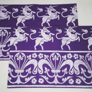 A set of 2 purple place mats with 14th century unicorn & 13th century fleur-de-lis print. Hand printed with my own hand carved stamps. The cotton canvas for the place mats is new & pre-washed. They are ready to be used & machine washable!