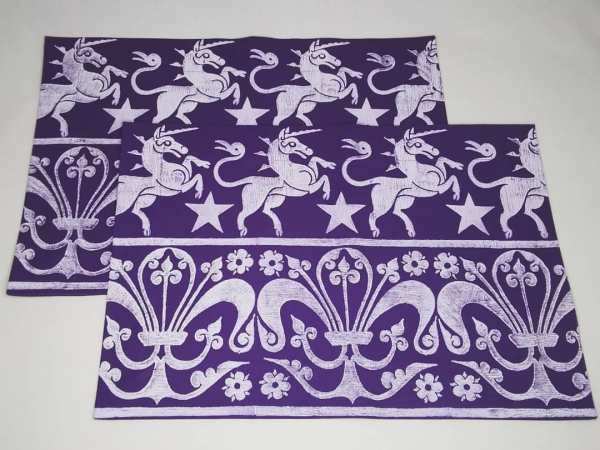 A set of 2 purple place mats with 14th century unicorn, stars & 13th century fleur-de-lis print. Hand printed with my own hand carved stamps. The cotton canvas for the place mats is new & pre-washed. They are ready to be used & machine washable!