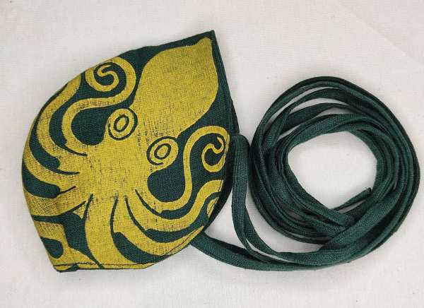 Dark green linen octopus face mask with long ties and yellow octopus print. New, pre-washed fabric, ready to wear and machine washable!