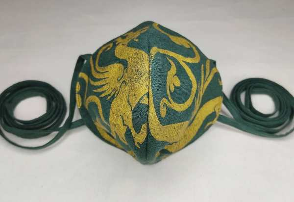 Lovely dark green linen dragon face mask with long ties and premium gold 13th century dragon print. New, pre-washed fabric, ready to wear and machine washable!