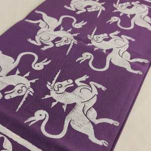 Purple table runner with 14th century unicorn and 13th century fleur-de-lis print. Hand printed with my own hand carved stamp. The cotton canvas for the table runner is new & pre-washed. The table runner is ready to be used & machine washable!