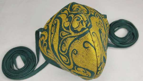 Dark green linen face mask with long ties and premium gold middle eastern inspired11th century lioness print. New, pre-washed fabric, ready to wear and machine washable!
