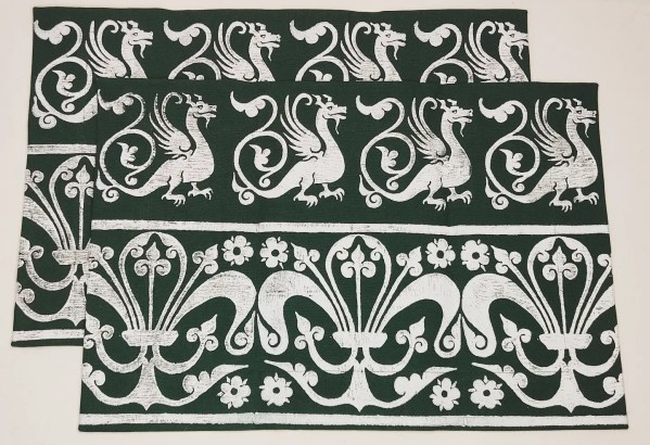 A set of 2 dark green place mats with 13th century dragon & fleur-de-lis print. Hand printed with my own hand carved stamps. The cotton canvas for the place mats is new & pre-washed. They are ready to be used & machine washable!