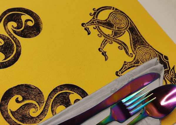 Celtic inspired art for your table in form of a set of 2 yellow place mats with wolf & triskele print. Hand printed with my own hand carved stamps. The cotton canvas for the place mats is new & pre-washed. They are ready to be used & machine washable!