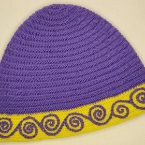 A one of a kind medium/large nalbinded cap with hand embroidery in purple & yellow Superwash Fine Merino Wool. Carefully worked by hand, hand embroidered, lovely soft & warm for a warm head during the next winter time!