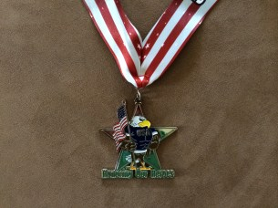 Honoring Our Heroes - race medal closeup