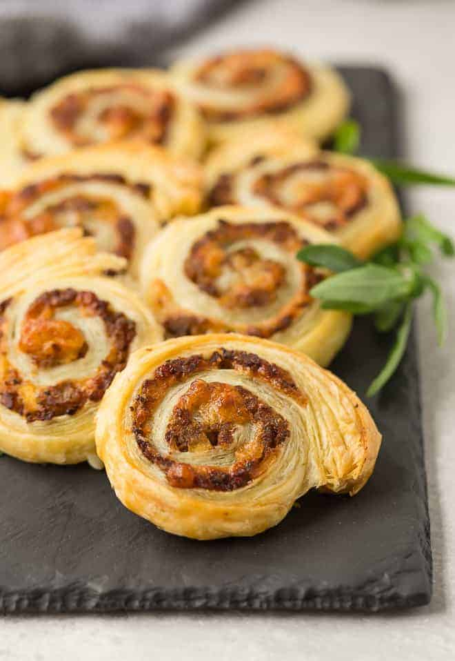 image of pinwheel appetizers made with sausage and apple.