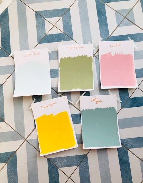 Craig and Rose colour test samples on hallway tiles