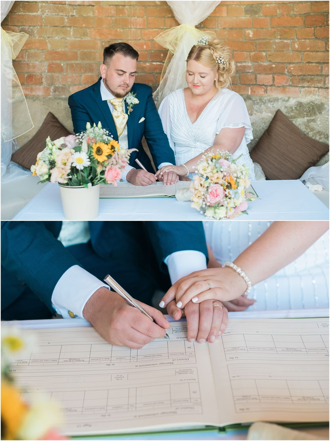 bride and groom signing the register at an outdoor ceremony