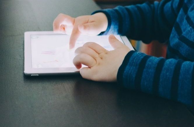Child using tablet for screen time