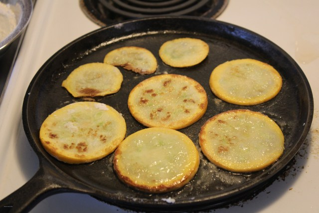 Frying zucchini slices on iron skillet