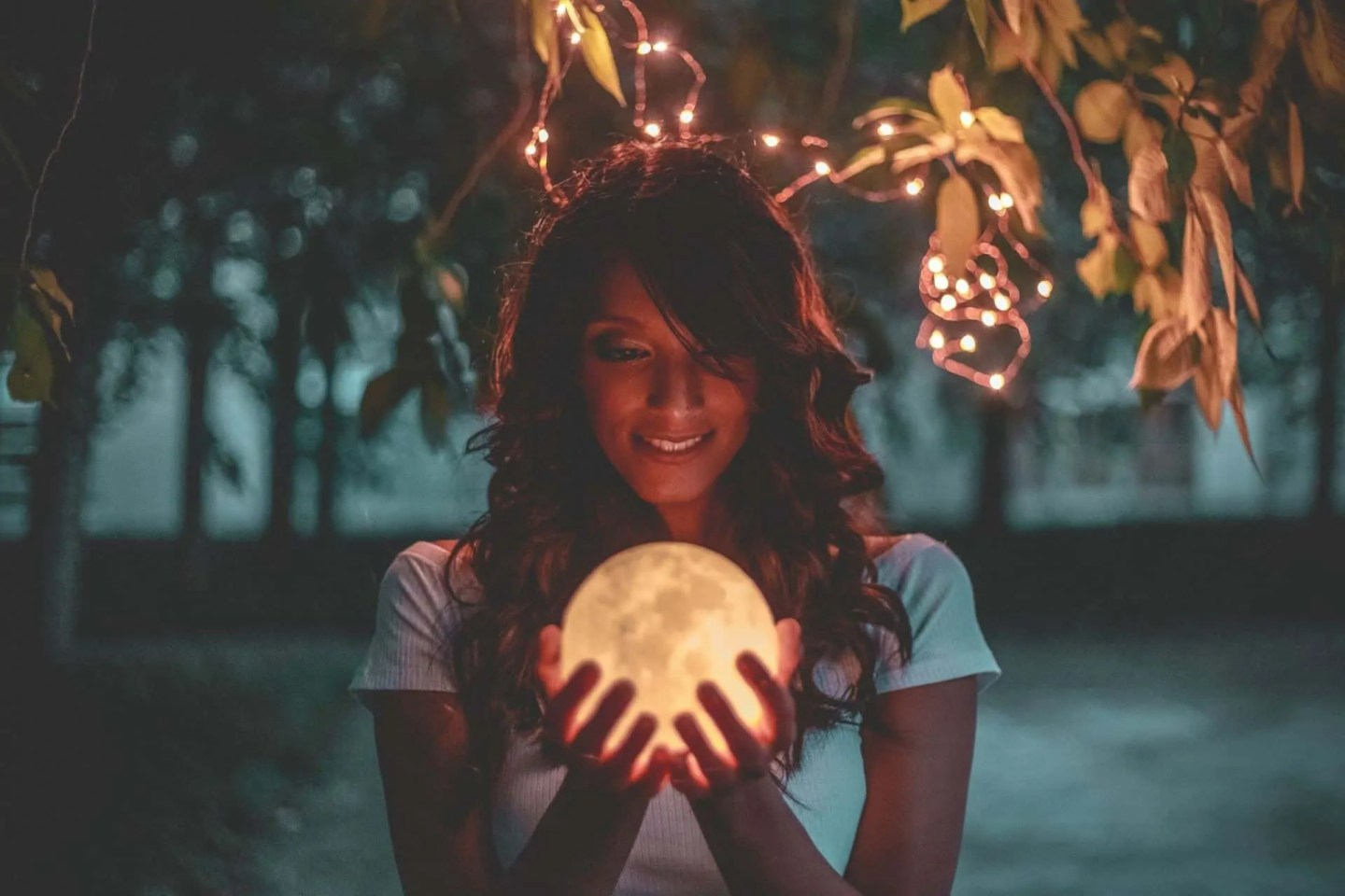 woman holding a moon ball