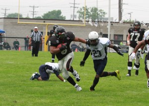 Racine Raiders running back J.R. Taylor finds a lot of room to roam against the Leyden Lions on June 21, 2104.
