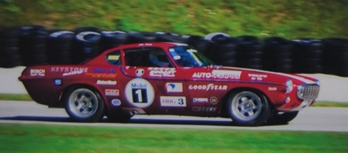 The Volvo at speed in a vintage sports car race.