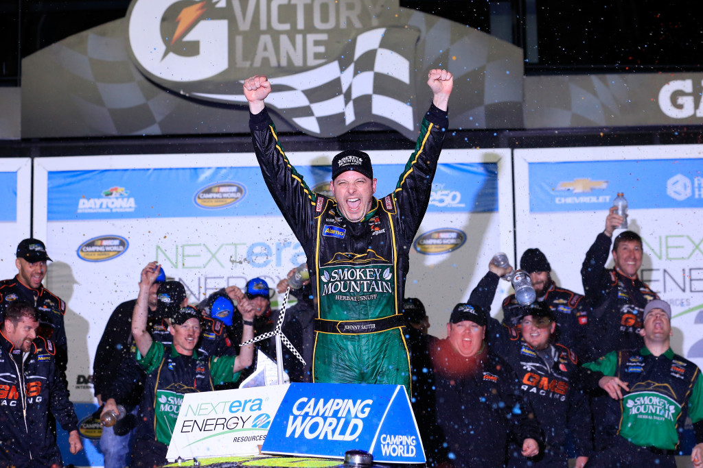 Johnny Sauter, driver of the #21 Smokey Mountain Herbal Snuff Chevrolet, celebrates in Victory Lane after winning the NASCAR Camping World Truck Series NextEra Energy Resources 250 at Daytona International Speedway on February 19, 2016 in Daytona Beach, Florida.  (Photo by Chris Trotman/NASCAR via Getty Images)
