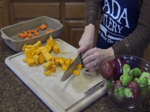 Jess cuts vegetables with the Rada French Chef.