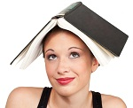 confused expression head shot with book on head