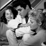 December 27, 1957 - Elvis Presley, poses with his house guests, Kathy Gabriel, 19, left, and Hanneri Melcher, 20, in Memphis. Melcher, Miss Austria 1957, met Elvis in Las Vegas in November 1957, and visited Graceland at Christmas time with her roommate, 1957's Miss Ohio, Kathy Gabriel as they were on their way to New York. Elvis had just received news of a 60-day draft extension to March 20. (Robert Williams/The Commercial Appeal )