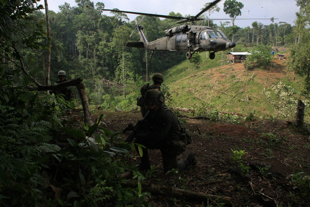 Colombian troops stand on guard after burning a coca laboratory near Tumaco, Colombia, in the southwest state of Narino, June,8, 2008, According to the Police nearly 30,000 hectares (75,000 acres) of coca fields have been fumigated and more than 130 laboratories destroyed in the south of the country since January. Colombia produces most of the world's cocaine. (AP Photo/William Fernando Martinez)