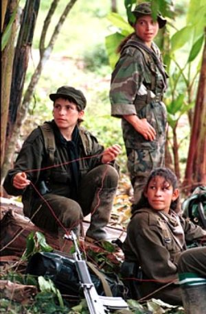 Colombia Farc Project: Three girls members of the Revolutionary Armed Force of Colombia, FARC, rest in a camp near La Macarena, in the rebel controlled area located in southern Colombia. Marcelo Salinas/Special to Chronicle