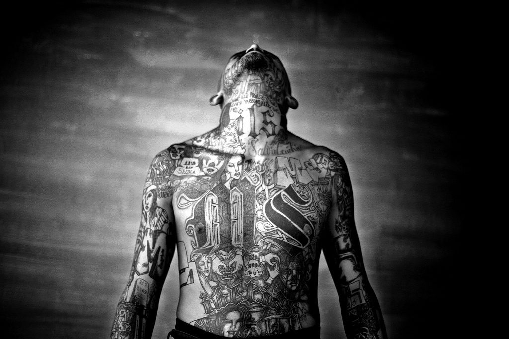 Member of the Mara Salvatrucha gang displays his tattoos inside the Chelatenango prison in El Salvador