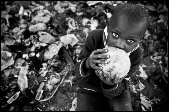 Poor Kenyan boy in Nairobi rubbish dump