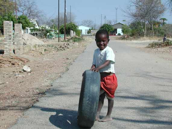 Boy playing in Bulawayo neighbourhood