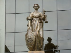 Lady Justice statue in front of Russian Supreme Court