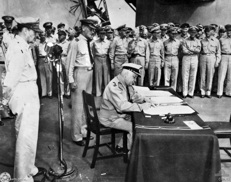 Dutch navy commander Helfrich signs the Japanese capitulation treaty on board the USS Missour on September 2, 1945 (Wikimedia)