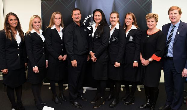 Members of the New Zealand hockey team model the team uniform for the 2014 Commonwealth Games in Glasgow, with coach Mark Hagar (centre), NZ Olympic Committee secretary Kereyn Smith (second from right) and president Mike Stanley.