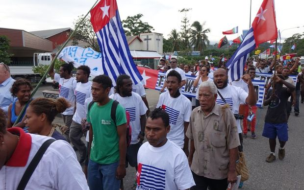 A march through the streets of Honiara in support of West Papua's bid for MSG membership