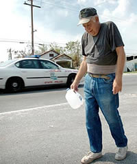 Bobby Rideau of New Orleans hangs his head after cars, including a state police vehicle, ignored his requests for water. Source:Andre F. Chung, Baltimore Sun