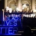 glowing black lives matter on steps