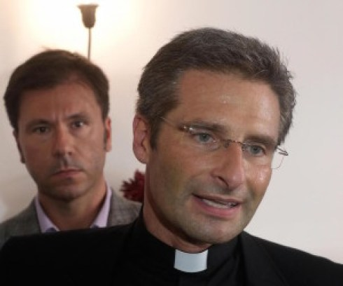 Monsignor Krysztof Charamsa, 43 , with his partner at the end of a press conference in Rome, Italy, 3 october 2015. ANSA/ LUCIANO DEL CASTILLO