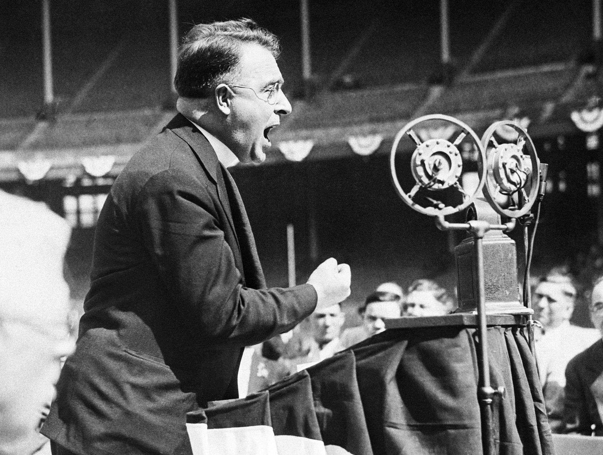 The Rev. Charles E. Coughlin of Detroit, Mich., is shown as he addressed a mass meeting of his followers in Cleveland, Ohio, May 11, 1936. He pleaded fro the support of the N.U.S.J. candidates in Tuesday's Ohio primary. (AP Photo)