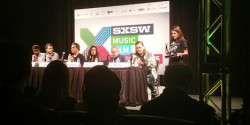 Paul Krugman (second from right) among the rockers at SXSW.
