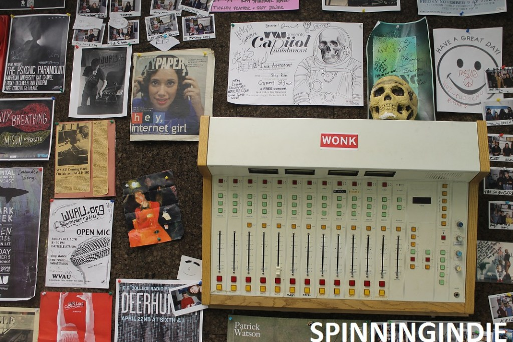 studio wall at college radio station WVAU with board and skull