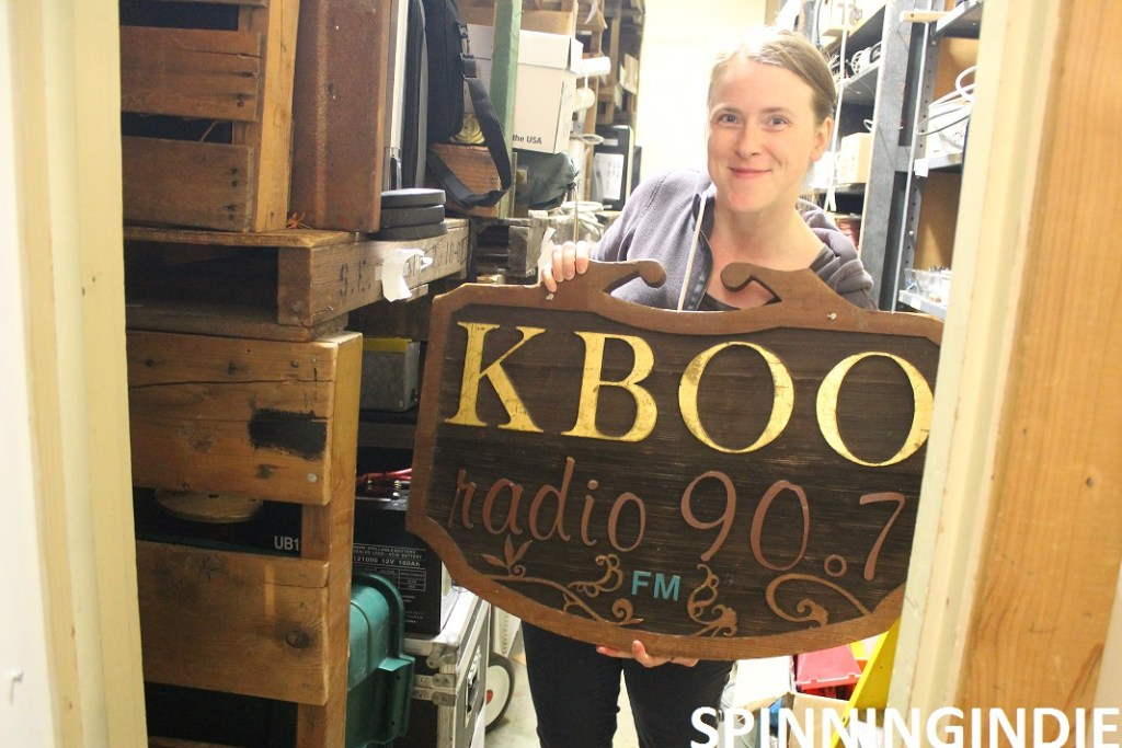 Becky Meier with KBOO sign. Photo: J. Waits