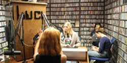 DJs in the on-air booth at college radio station KUCI. Photo: J. Waits